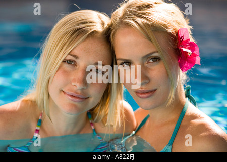 Two women in a swimming pool - Stock Photo