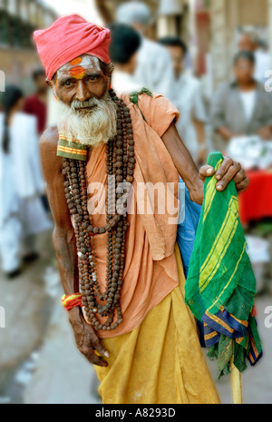 A religious hindu man walks on the street of Mumbai (Bombay) in India - Stock Photo
