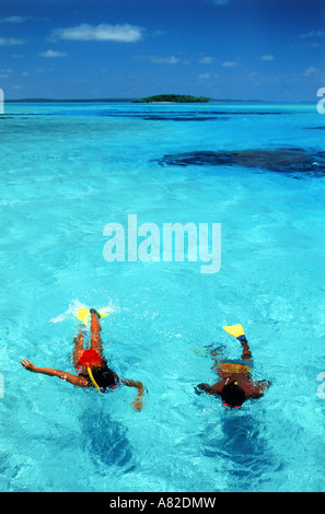 Looking down on couple snorkling in Aitutaki lagoon in Cook Islands  South Pacific - Stock Photo