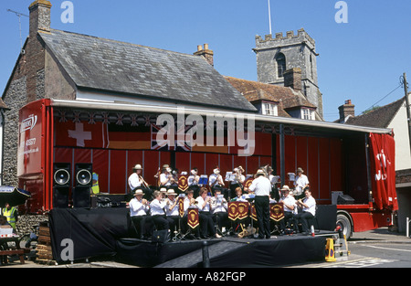 Wareham Town Band rehearse on the quay at Wareham prior to giving an evening concert - Stock Photo