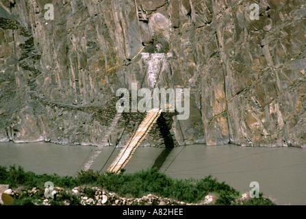 Pakistan Azad Kashmir Gulmit rope bridges over the Hunza river - Stock Photo
