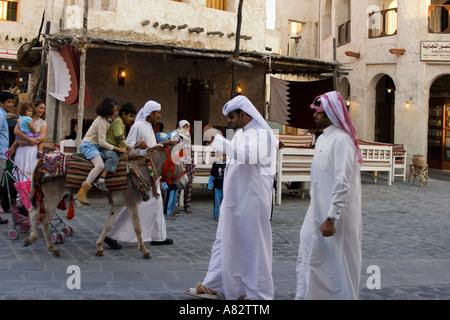 Qatar Doha Souk children on donkey - Stock Photo