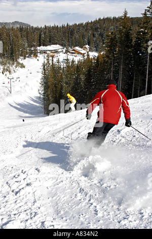 Skiers on the slopes at Bansko ski resort Bulgaria - Stock Photo