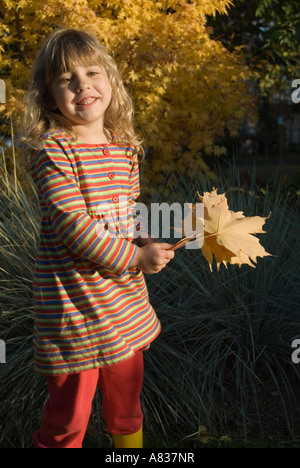 Young Girl with Yellow Leaves - Stock Photo