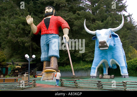 Giant statues of Paul Bunyan and Babe the Blue Ox guard the entrance to the Trees of Mystery at Klamath California - Stock Photo