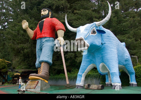 Giant statues of Paul Bunyan and Babe the Blue Ox guard the entrance of the Trees of Mystery at Klamath California - Stock Photo
