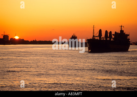 Ships at sunset on the Mississippi River near New Orleans Louisiana - Stock Photo