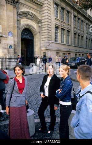 French students socialize outside the Sorbonne in Paris France - Stock Photo