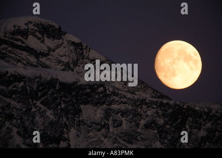 Full moon rising over Mt Alice Chugach National Forest Seward Alaska - Stock Photo