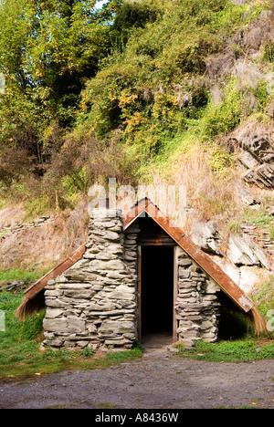 Restored cottage in Arrowtown Chinese gold miners settlement Otago New Zealand - Stock Photo