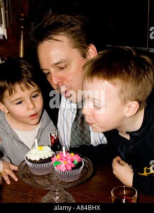 Boys age 4 and 7 singing happy birthday to dad age 38 St Paul