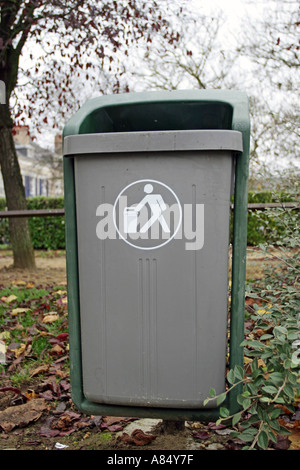 Bin in france street during autumn season - Stock Photo