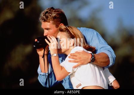 Couple Outdoors Binoculars - Stock Photo