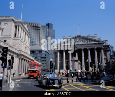 Black London taxi and red London bus in the financial district of the City of London, England, UK. - Stock Photo
