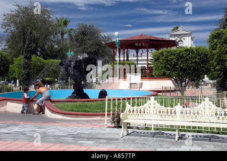 The main square or Jardin Velasco in front of the Cathedral at La Paz Mexico - Stock Photo