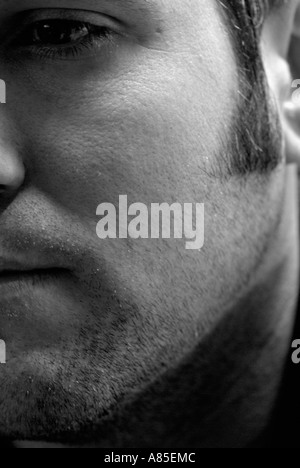 Mono Abstract of a Caucasian Adult Males Face - Stock Photo