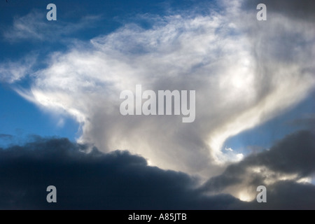 Weird clouds, unusual cloud, strange clouds, bizarre clouds. Cloud convection Anvil shaped formation patterns over - Stock Photo