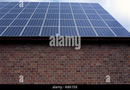 BP solar panels on farm buildings, Wagenfeld, Lower Saxony, Germany. - Stock Photo