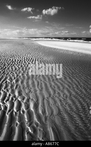 Ripples in the sand, left by an ebbing tide, North Norfolk coastline - Stock Photo