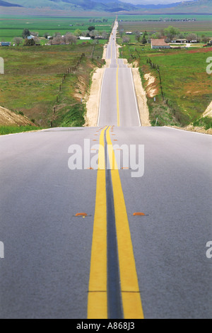 Rolling country road in Kern County, California - Stock Photo