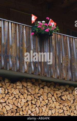 Swiss flag and flower pot Binn Wallis Switzerland August 2006 - Stock Photo