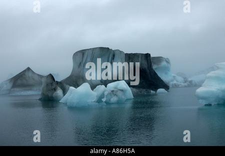 Icebergs in Jokulsarlon glacial lagoon calved from Breidamerkurjokull glacier Iceland - Stock Photo