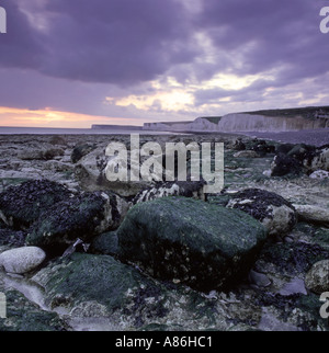 Sunset viewed from the beach at Birling Gap beach on the South Downs way - Stock Photo