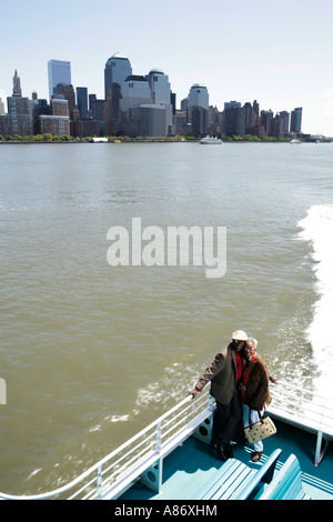 Mature couple standing on a boat - Stock Photo