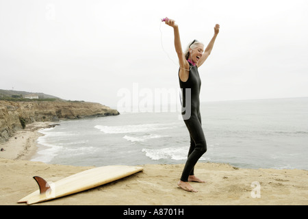 View of a woman rejoicing on a shore. - Stock Photo