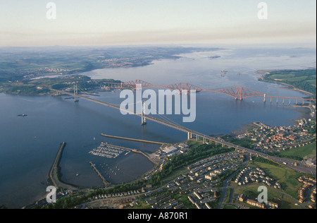 Firth of Forth road and rail bridges Scotland aerial views - Stock Photo