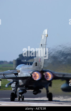 GR4 Panavia Tornado twin engined jet on full afterburner about to take off from RAF Lossiemouth Morayshire - Stock Photo