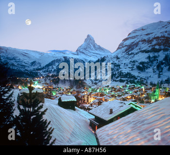 View over the resort towards the Matterhorn at dusk, Zermatt, Switzerland - Stock Photo