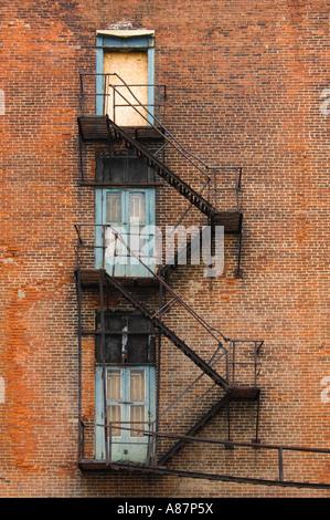 Dilapidated fire escape Philadelphia Pennsylvania USA - Stock Photo