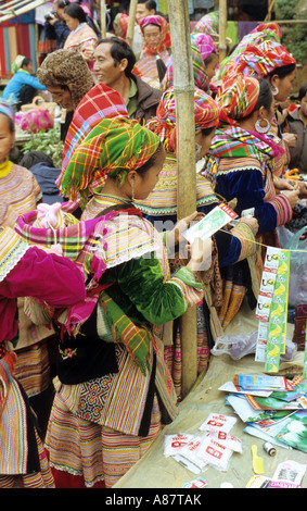 Traditionally dressed Flower Hmong women at a stall at the Saturday market, Can Cau, NW Viet Nam - Stock Photo