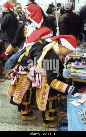 Traditionally dressed Red Dzao women at the market, Sapa, NW Viet Nam - Stock Photo
