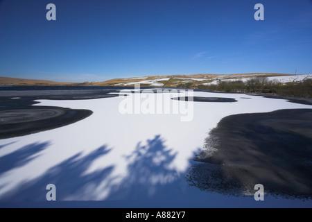 Belmont reservoir frozen in winter after snowfall Lancashire UK - Stock Photo