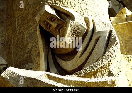 Chiselled figure of a man carved in stone on the exterior of the unfinished Temple de la Sagrada Familia, Barcelona, - Stock Photo