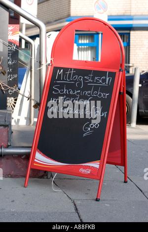 Menu board at a restaurant in Hamburg - Stock Photo