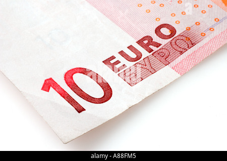 Single ten euro bank note cut out on white background - Stock Photo