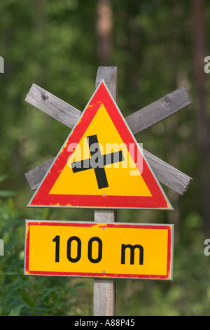 Finnish traffic sign warning about Intersection with equal roads ( give way to the vehicles coming from the right - Stock Photo