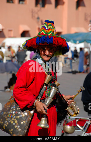 Water seller colourful dressed Djemaa el Fna Marrakech Morocco - Stock Photo