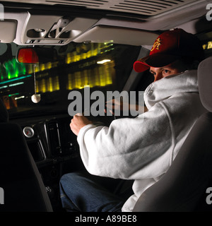 Young Joyrider at the wheel of stolen car - Stock Photo