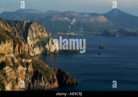 View over steep coastline of Lipari in evening light Liparian islands, Sicily, province of Messina, Italy - Stock Photo