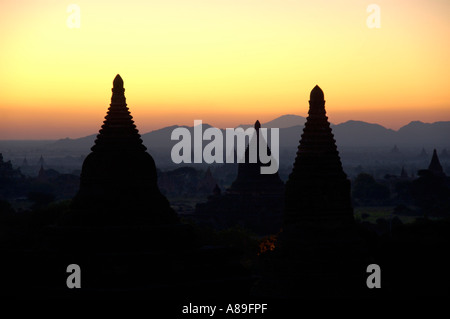 Morning red over stupas as silhouettes Bagan Burma - Stock Photo