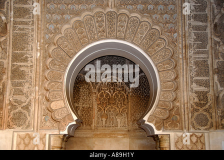 Oriental detail of with fine stucco richly decorated mihrab Medersa Ali Ben Youssef medina Marrakech Morocco - Stock Photo