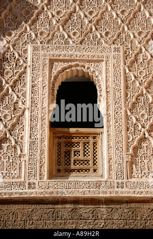 Oriental window with fine stucco richly decorated Medersa Ali Ben Youssef medina Marrakech Morocco - Stock Photo