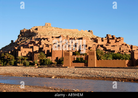 Traditional Berber architecture Kasbah Ait Benhaddou at river and mountain slope Morocco - Stock Photo