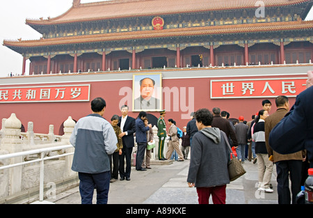 CHINA BEIJING Chinese couples pose to have their photos made in front of the giant portrait of Chairman Mao - Stock Photo