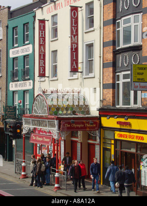 Olympia Theatre exterior in Dame Street, people walking, people waiting to cross, photographed daytime in 2003, - Stock Photo