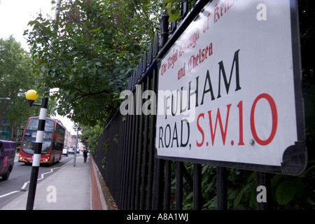 Fulham road SW10 street sign streetsign with london bus - Stock Photo